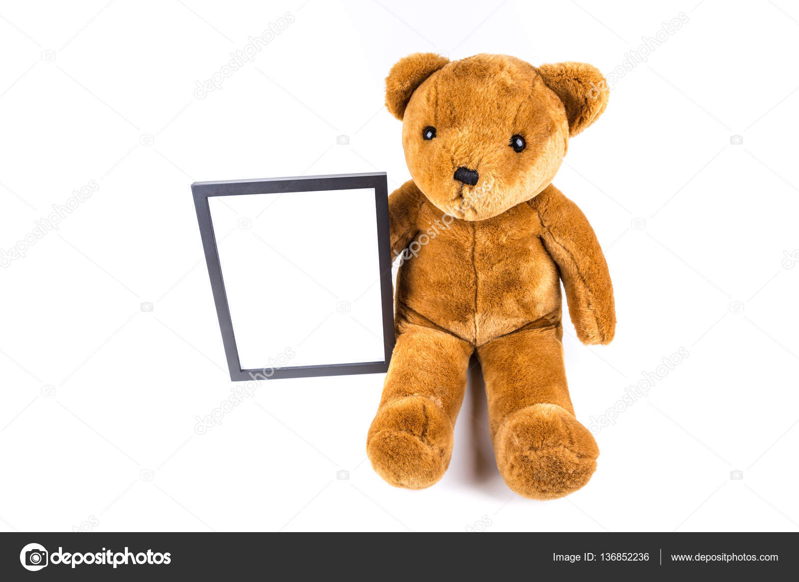 Brown fuzzy teddy bear holding a black frame — Stock Photo ...