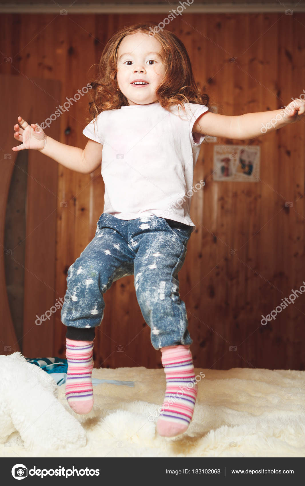 Funny Baby Jumping On The Bed Stock Photo