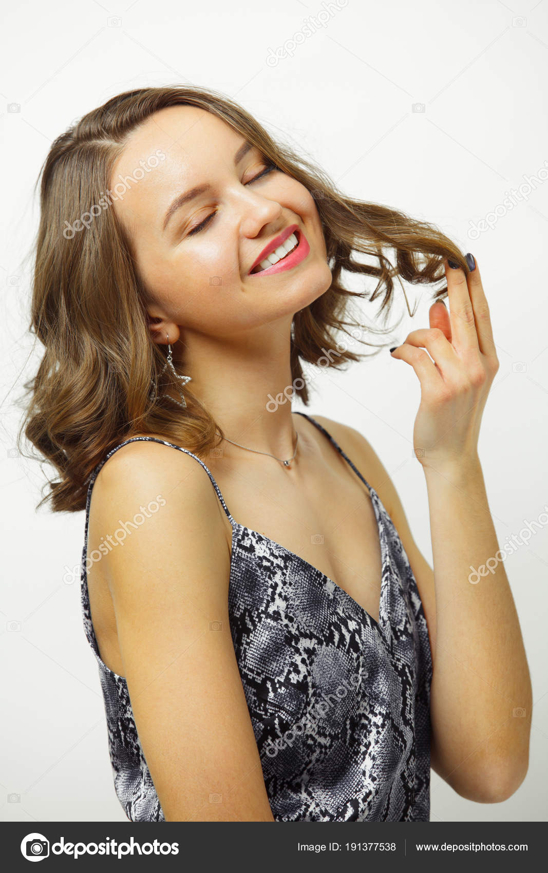 Shot Of Smiling Woman With Short Haircut Keeps Hair Satisfied With