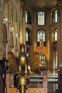 Gilt lectern inside Peterborough Cathedral, UK.