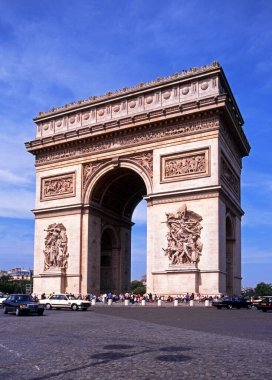 View of the Arc de Triomphe along the Place Charles de Gaulle at the end of the Champs-Elysees, Paris, France.