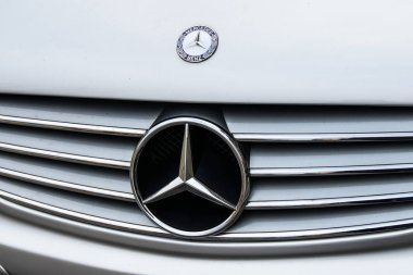 Milan, Italy - February 19, 2017 - Mercedes Benza car logo on a silver Mecedes Benz car.