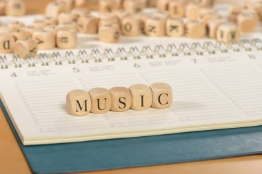 Music word on wooden cubes. Music concept