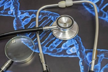 stethoscope, magnifying glass and genetic diseases research