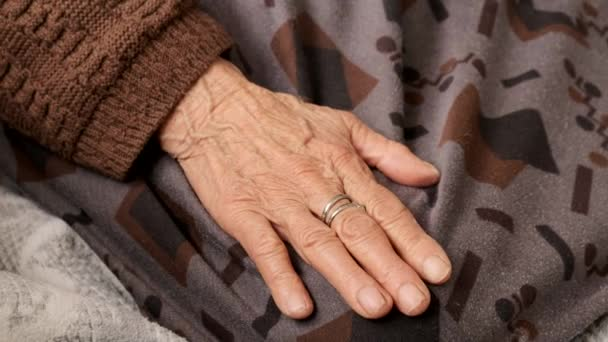 to favor older people, be nice to the elderly,a young person tenderly holds the hand of the elderly,