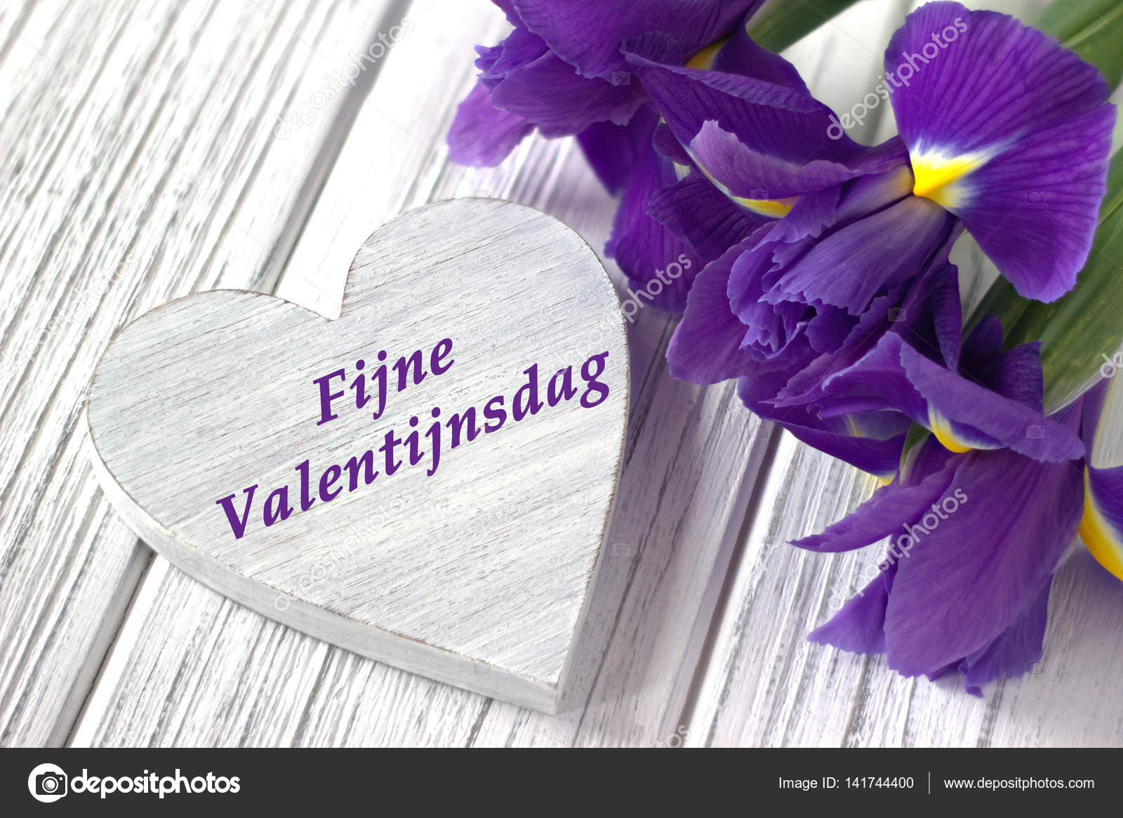 Still life with heart sign iris flowers on white wooden background still life with heart sign iris flowers on white wooden background wedding valentines day greeting card with text happy valentines day in dutch kristyandbryce Gallery