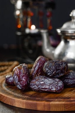 Dates for iftar on wooden board for ramadan month