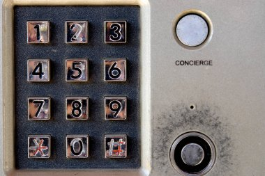Security system - intercom on building with keypad and lock