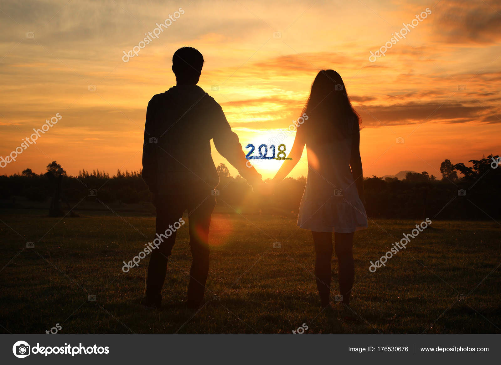 happy new year 2018 shadow image of couples holding hands with stock photo