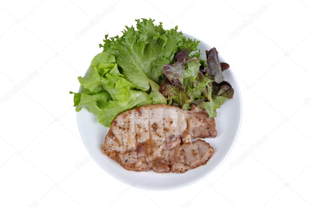 Homemade cooking of Pork Chop Steak served with mixed vegetable as red oak , green oak and lettuce