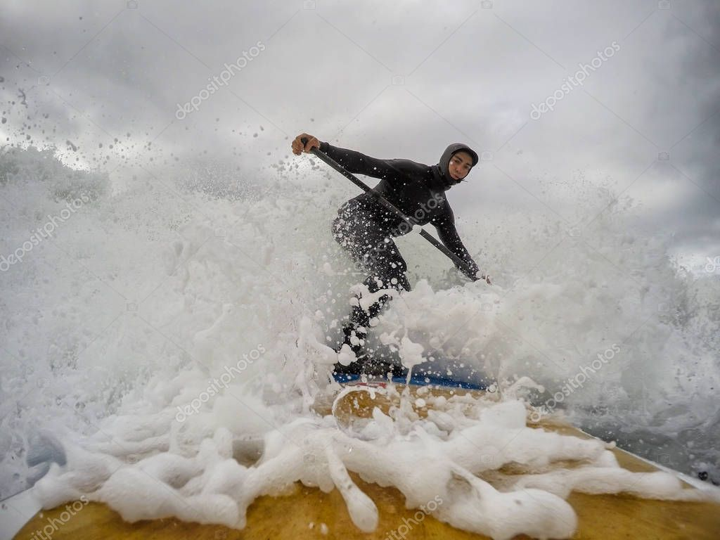 Wave Splash behind Surfer