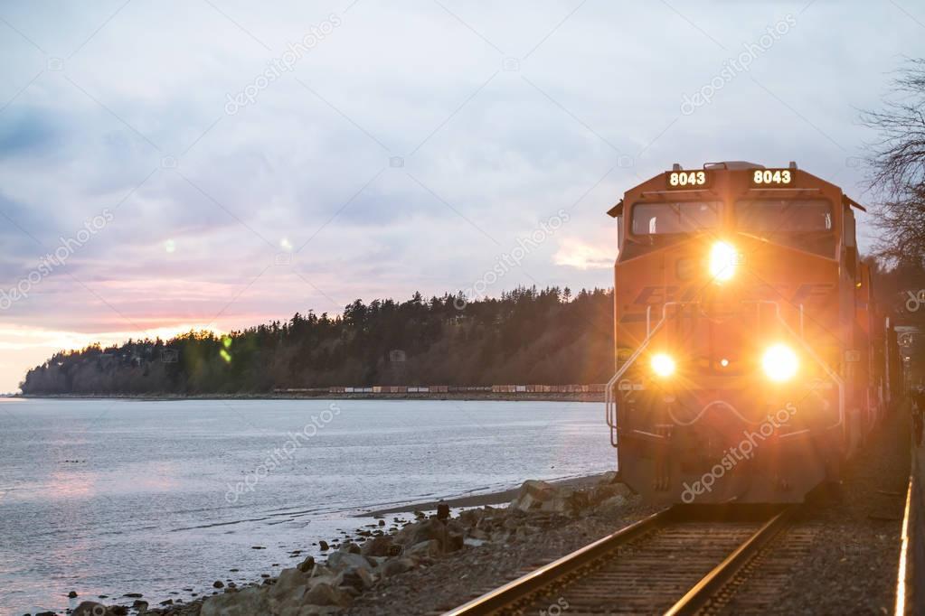 Train riding through city