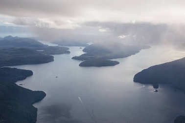 Aerial view of the Inlet near Sunshine Coast, British Columbia, Canada. Taken during a cloudy and rainy evening.