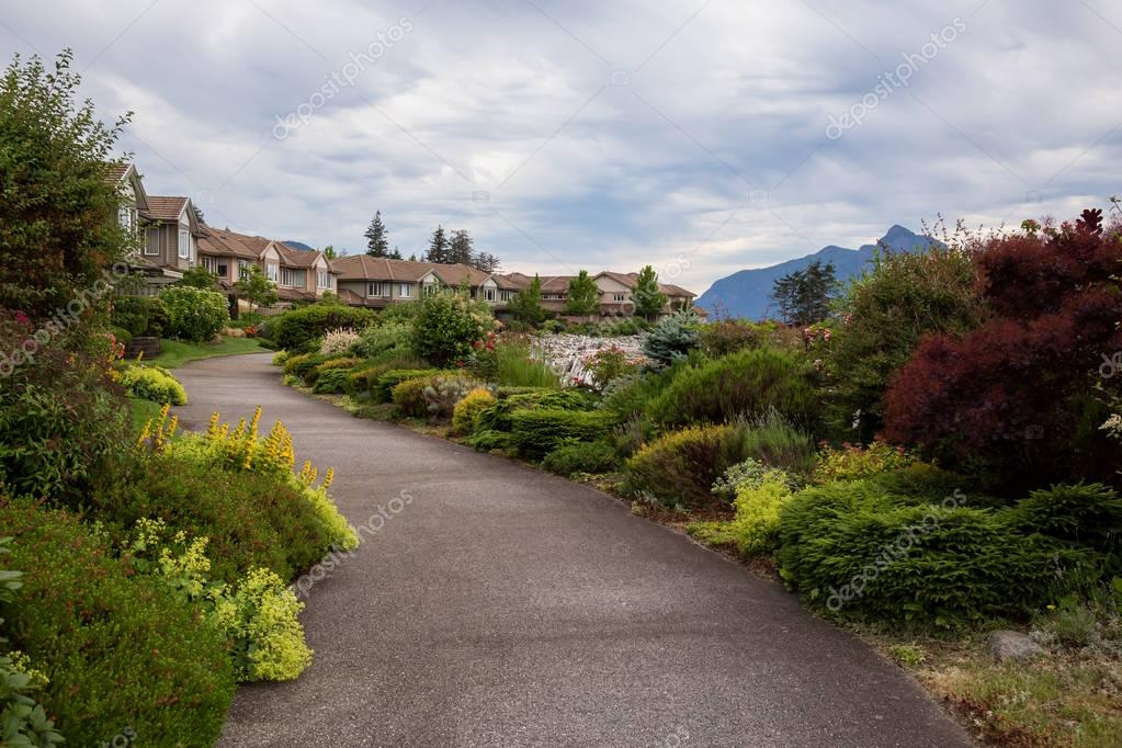 Furry Creek, British Columbia, Canada - Jun 25, 2017 - Path in the garden of beautiful townhomes.
