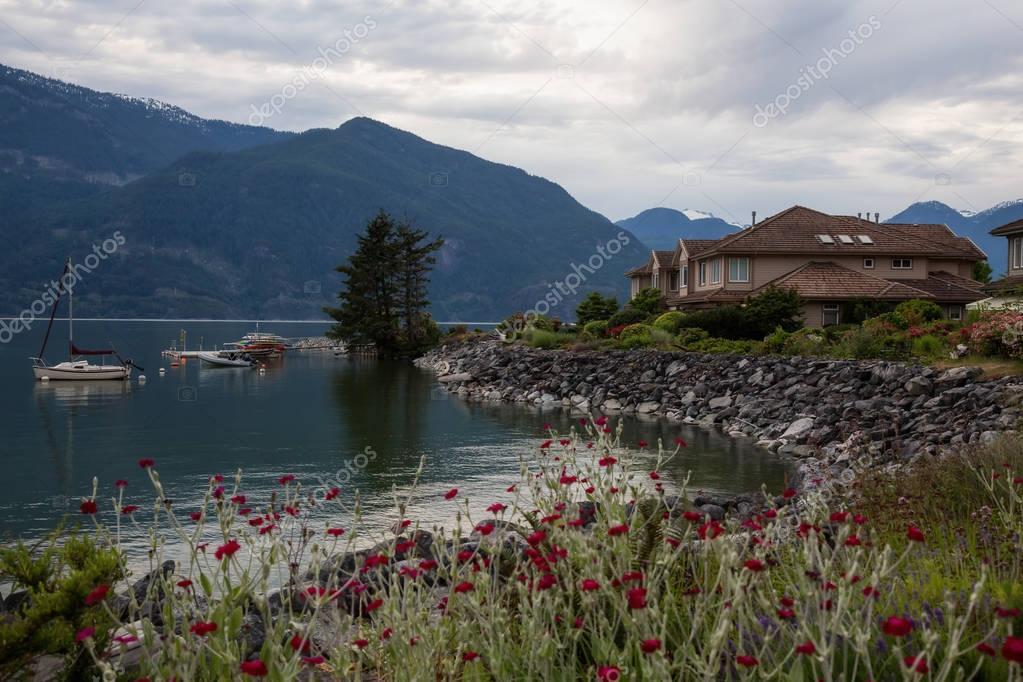 Furry Creek, British Columbia, Canada - Jun 25, 2017 - Path in the garden of beautiful townhomes.