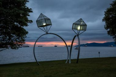 Downtown Vancouver, British Columbia, Canada. Artistic Light fixtures in form of rings at Sunset Beach Park.