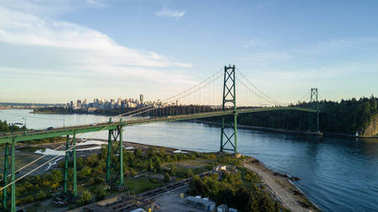 Aerial View of Lions Gate Bridge, Stanley Park and Downtown City in the background. Taken in Vancouver, British Columbia, Canada.
