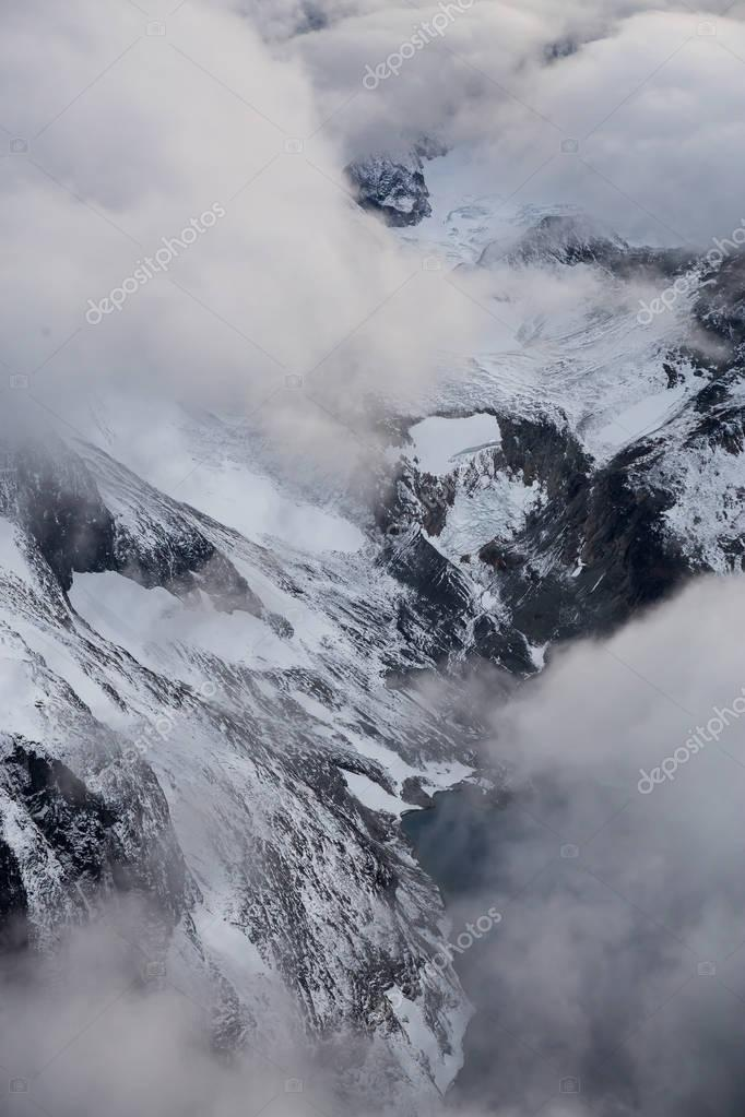 Aerial Rugged Landscape Above Clouds