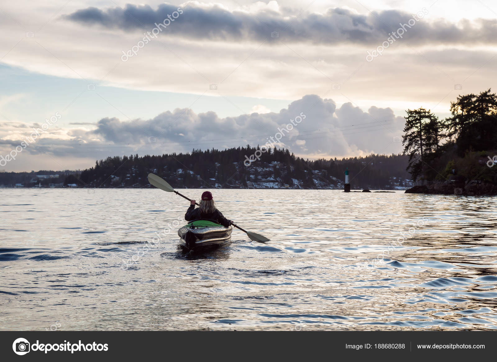 Adventurous Girl Is Kayaking On An Inflatable Kayak During A Vibrant Winter Sunset Taken In Indian Arm Deep Cove Vancouver BC Canada