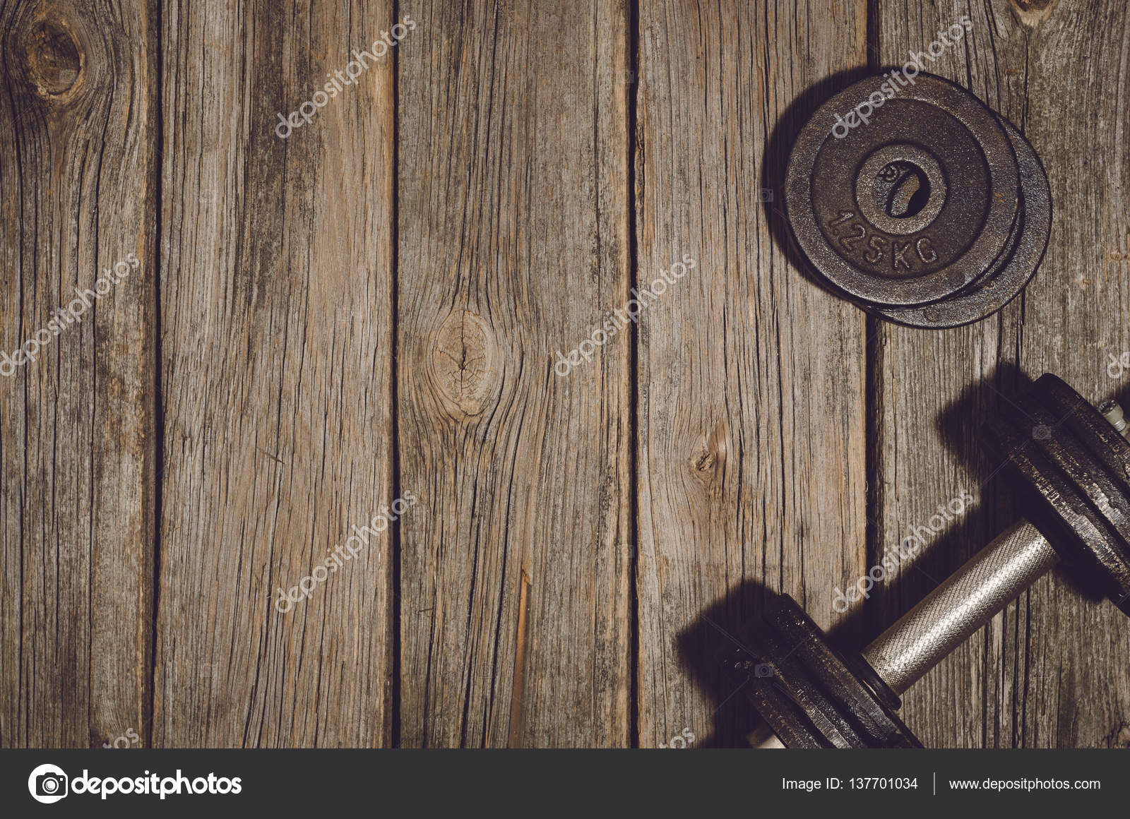 fitness workout background dumbbells on wooden gym floor