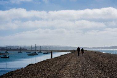 couple walking on the coast