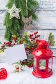New Year card. Red candlestick and sprig Christmas tree. The theme of the new year and Christmas. Empty space for text