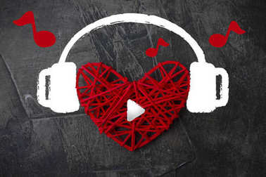 Heart in headphones on a dark background. Theme for Valentine's Day. Wedding, love 2