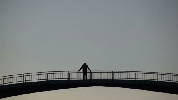 man in the middle of the bridge