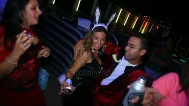 young Hugh Hefner with Playboy bunny, Happy Halloween.People in costumes dance at Halloween party in club October 31, 2016, New York, USA