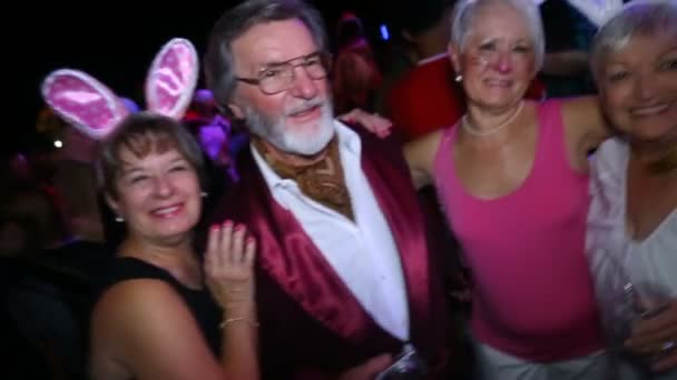 old Hugh Hefner with old Playboy bunnys, Happy Halloween.People in costumes dance at Halloween party in club October 31, 2016, New York, USA