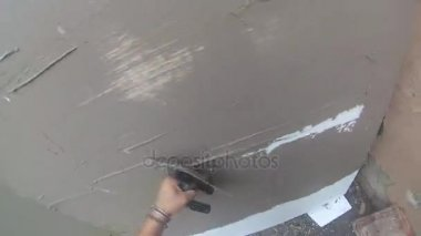 4k, male workers' hands are plastering the wall
