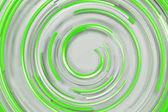 Bílé soustředné spirály s zelenou zářící prvky na bílém bac