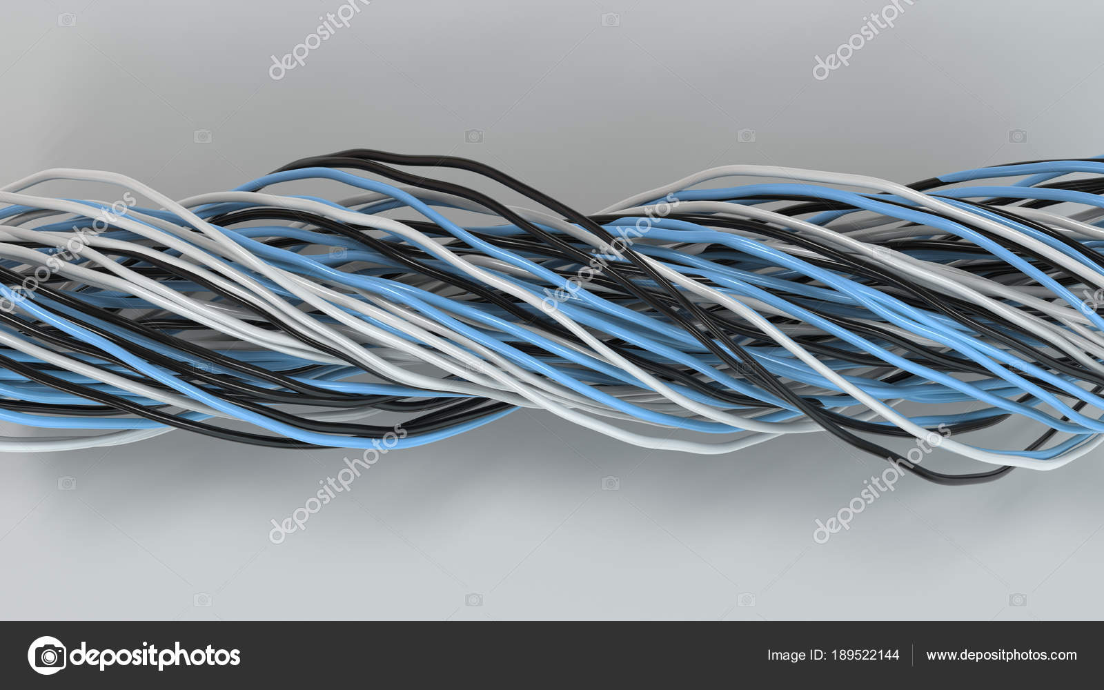 Twisted black, white and blue cables and wires on white surface ...