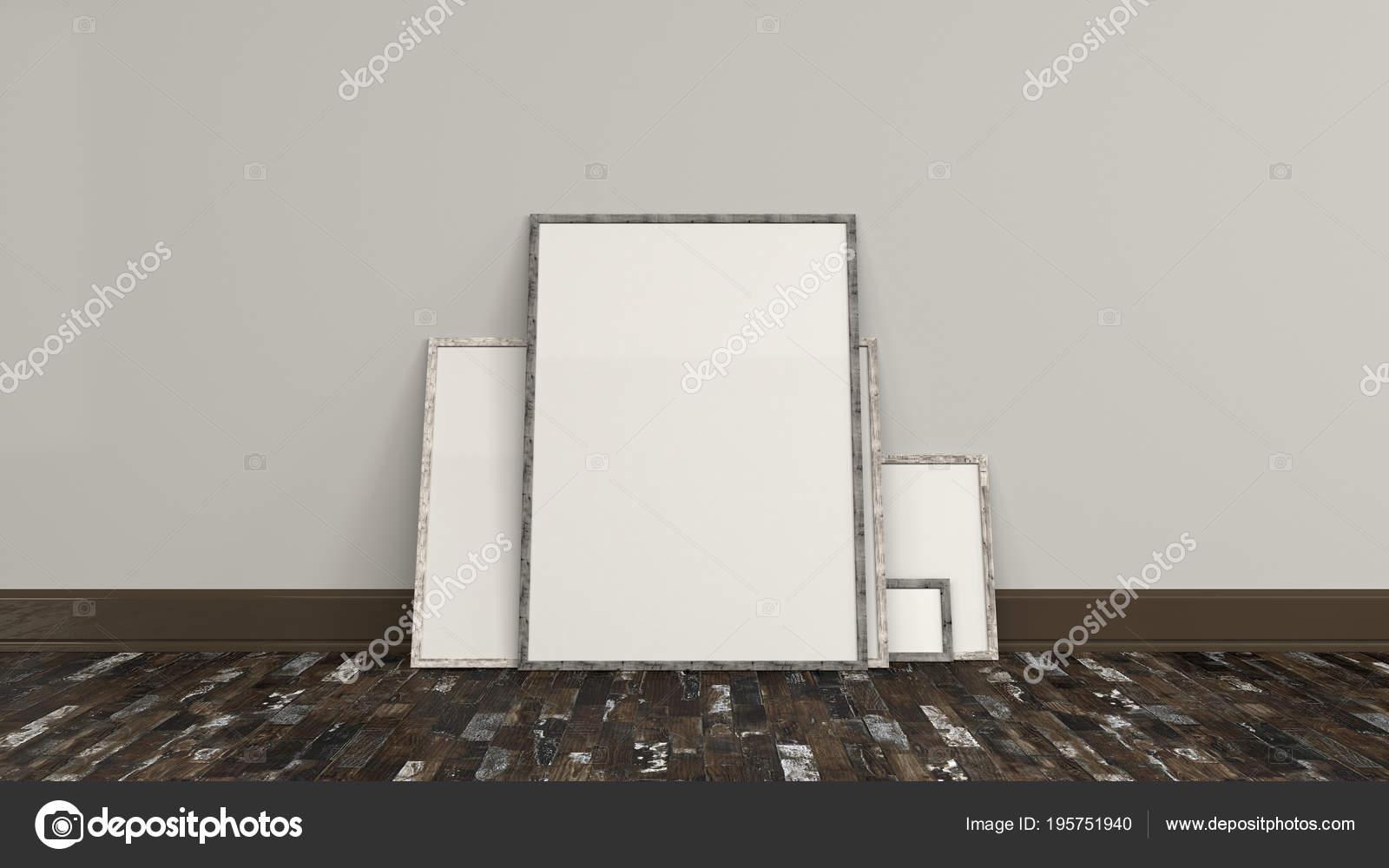 Carteles en blanco blanco en marcos de madera en pie en el piso ...