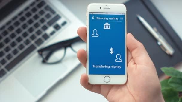 Sending money on banking app on the smartphone