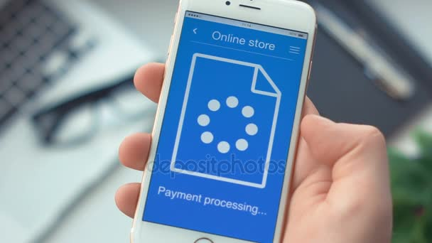 Paying for goods on online store app on the smartphone