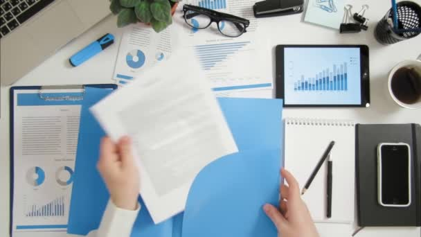 Top view businessman reading contract and highligting important information at office desk