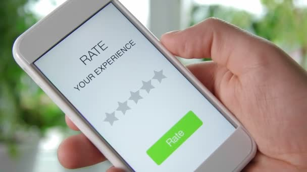 Man gives five star rating using smartphone application