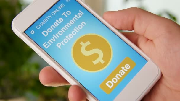 Man making an online donation environmental protection using charity applicaiton on smartphone