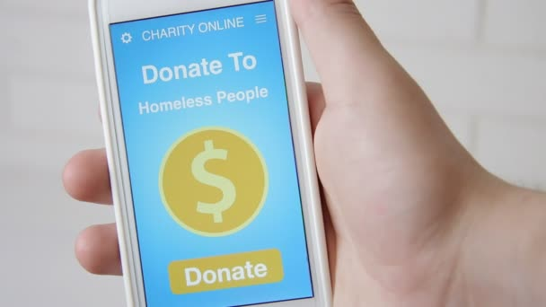 Man making an online donation to homeless people using charity applicaiton on smartphone