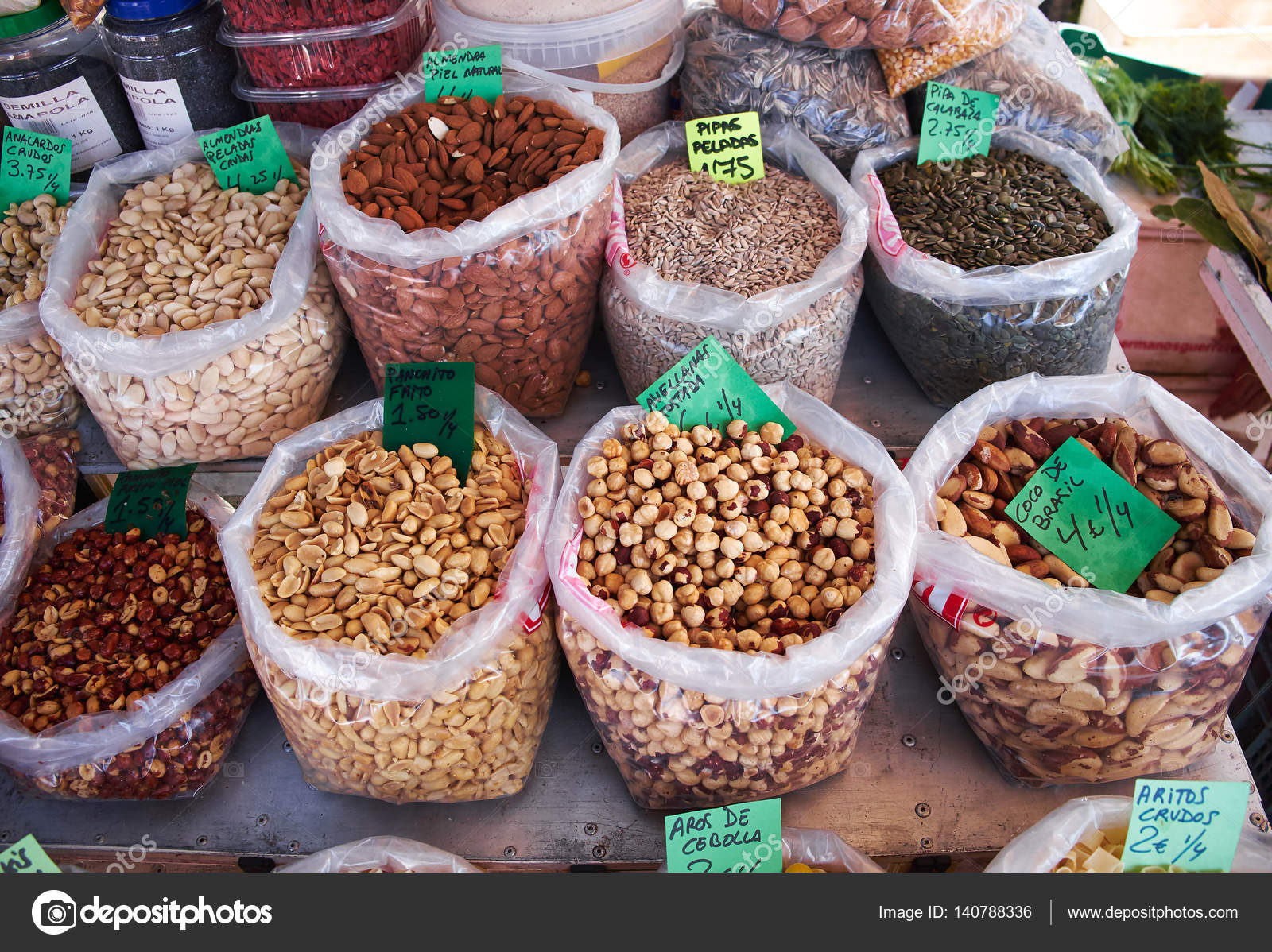 Many bags of various types of nuts for sale at Sunday market