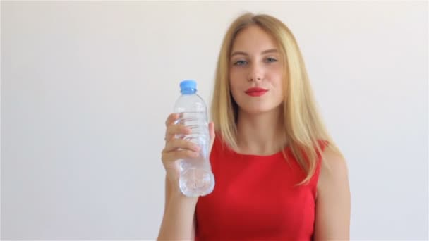 Young pretty girl drinking mineral water