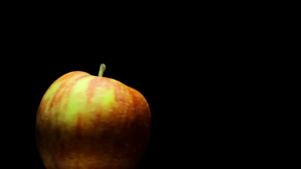 Delicious juicy apple on a black background