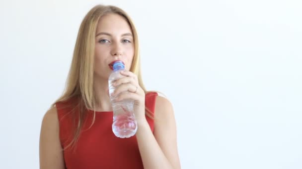 Young pretty girl drinks water