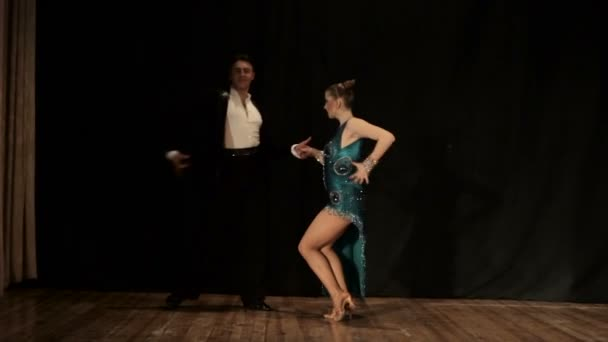 Couple, young beautiful woman and young man dance