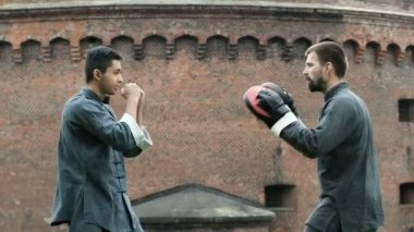 Two man fighting at training in traditional wear