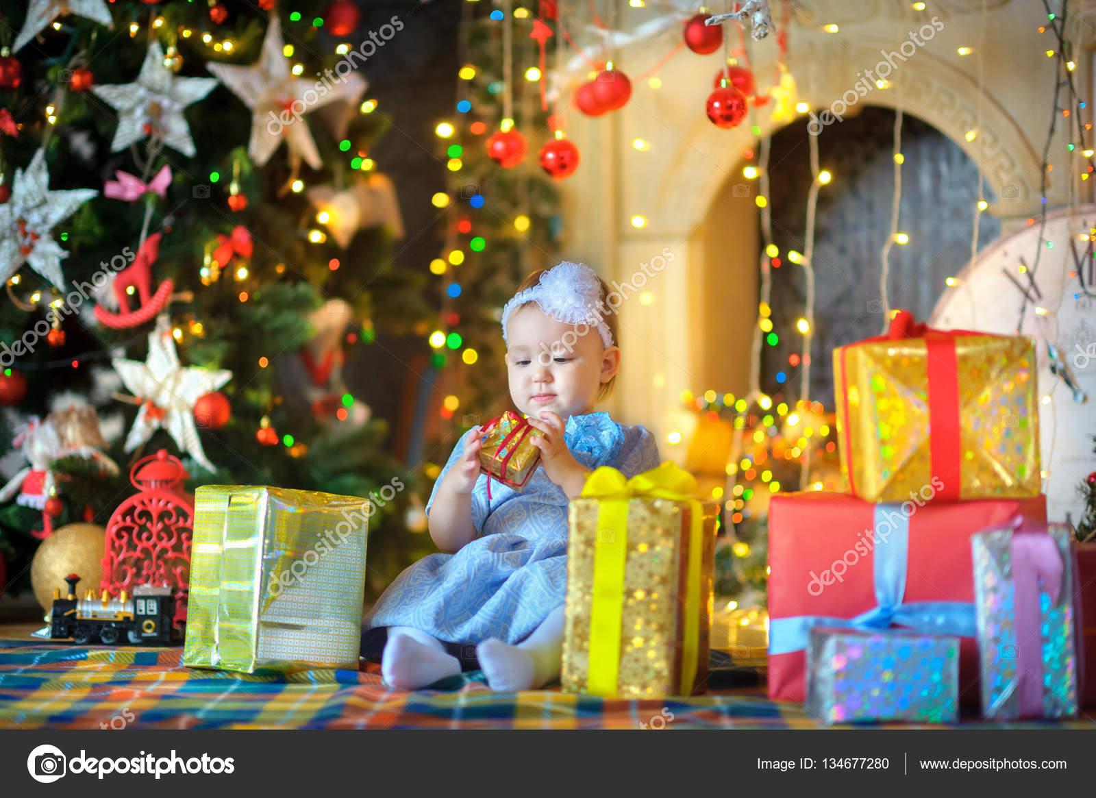 little girl with Christmas gifts — Stock Photo © fotosaga #134677280