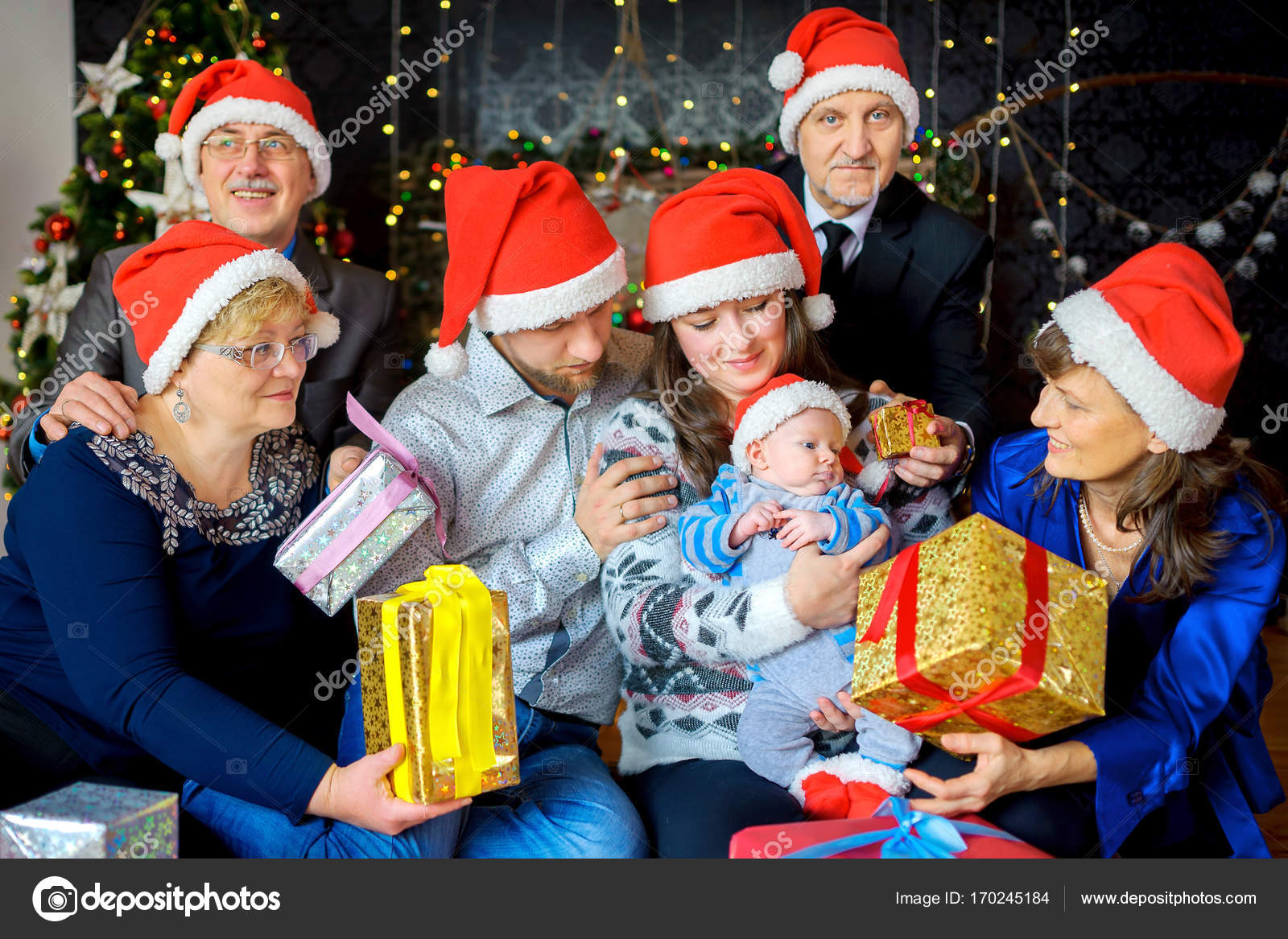 a big friendly family celebrates christmas gives gifts to the kid and has fun photo by fotosaga - Who Celebrates Christmas
