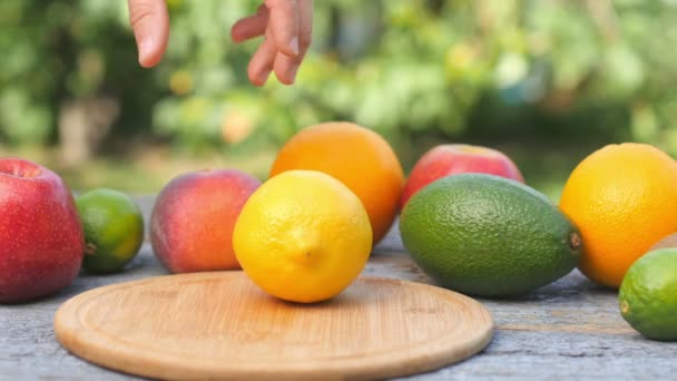 Ripe lemon is ripened on a cutting board. Fresh fruits on the table. Juicy lem cut in half. Avocado Lemon and apple on the background.