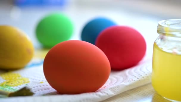 Happy easter. Close up of bright colored easter eggs on the table. Colorful easter eggs.